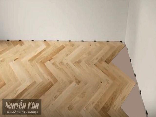 quy trình thi công lắp đặt sàn gỗ kiểu xương cá